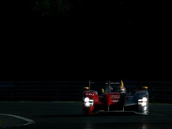 Tom Kristensen drives of the #7 Audi Team Sport Joest Audi R15 during the 78th running of the Le Mans 24 Hour race. (Darrell Ingham/Getty Images)