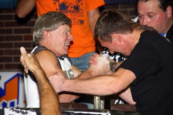 STRONG ARM:Norm Devio, 68, of  Massachusetts, competes in the arm wrestling championship at Port Authority Bus Terminal in New York on Thursday.  (Epoch Times)