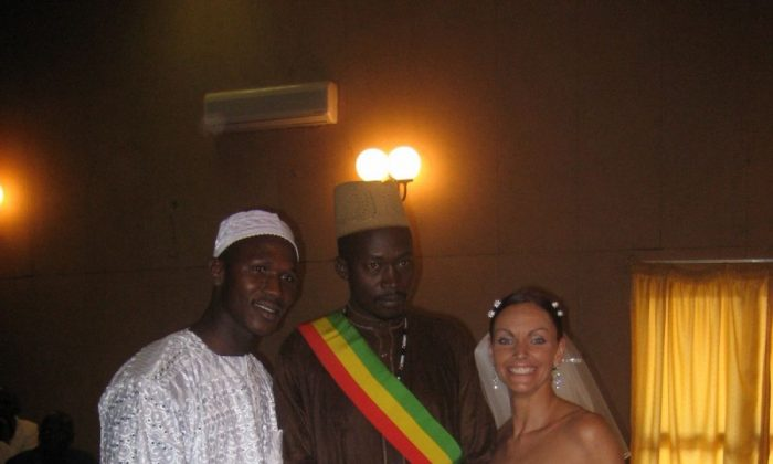 Lainie Towell and Fodé Mohamed Soumah (L) on their wedding day in Guinea, West Africa, in 2007. Towell's efforts to bring attention to her own case of marriage fraud may have contributed to tighter laws currently being introduced by the government to deter marriages of convenience. (Courtesy of Lainie Towell)
