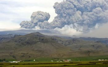 Ash billows from the Eyjafjallajokull volcano on May 8, in Hvolsvoellur, Iceland. The ash cloud grounded flights in several European countries on Sunday and affected transatlantic operations as well.  (Halldor Kolbeins/AFP/Getty Images)