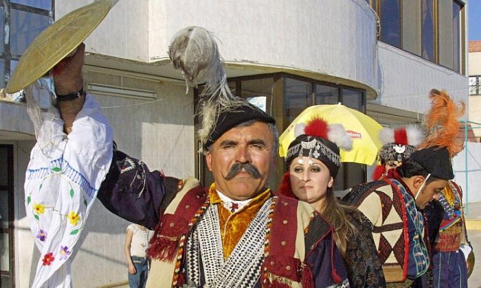 File photo of Iraqi Assyrians in Damascus, Syria, wearing traditional dress to celebrate New Year's. Assyrians fear they will be subject to persecution should the Assad regime to fall in Syria, says Rima Haro, an Assyrian and Middle East expert living in Sweden. (Louai Beshara /AFP/Getty Images)