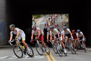 The peloton passes under a bridge in Auburn, California during Stage One of the 2010 Tour of California. (Doug Pensinger/Getty Images)