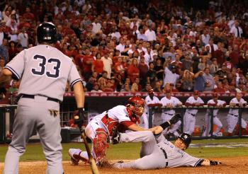Hideki Matsui #55 of the New York Yankees slides into home base safe ahead of Jeff Mathis #5 of the Los Angeles Angels of Anaheim tag during the seventh inning in Game Five of the ALCS during the 2009 MLB Playoffs at Angel Stadium on October 22, 2009 in A (Kevork Djansezian/Getty Images)