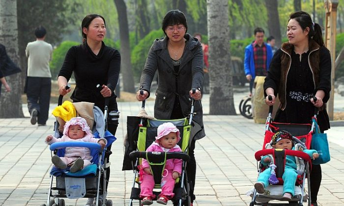 Women push babies in strollers through a Beijing park during a holiday on April 5, 2011. A dragon baby boom is expected in Asia this year. (AFP/Getty Images)