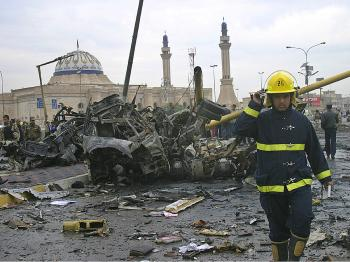 An Iraqi fireman surveys the damage at the site of a car bomb explosion on December 8, 2009 in Baghdad, Iraq. (Getty Images)