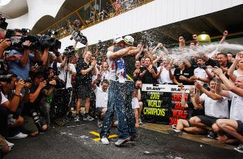 Jenson Button (L) is congratulated by team mate Rubens Barrichello (R) of Brazil and Brawn GP as he celebrates in the pitlane after clinching the F1 World Drivers' Championship. (Mark Thompson/Getty Images)