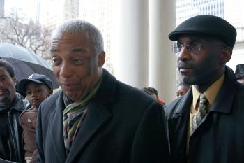 FREEDOM PARTY CALL: Councilman Charles Barron (L) stands with Freedom Party attorney Roger Wareham (R) to announce the party will look into legal action to end mayoral control over the schools system.  (Tara MacIsaac/The Epoch Times)