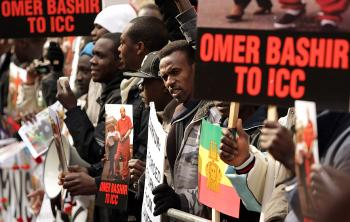 Protesters campaigning for the indictment of Sudan's president Omar al-Bashir demonstrate outside the Sudanese embassy in London.   (Oli Scarff/Getty Images)