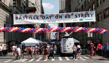 BASTILLE DAY: New Yorkers pack in on 60th Street to partake in the French National Holiday celebrations. (Diana Hubert/Epoch Times Staff)
