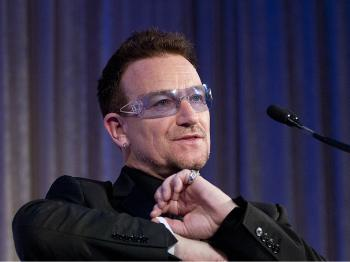 U2 frontman Bono speaks after being awarded the Distinguished Humanitarian Leadership Award during the 2010 Atlantic Council awards dinner at the Ritz Carlton Hotel on April 28, 2010 in Washington, DC. (Kris Connor/Getty Images)