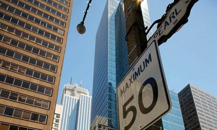 A report by Toronto's chief medical officer David McKeown says speed limits should be lowered in the city to increase pedestrian and cyclist safety. (Chip Somodevilla/Getty Images)