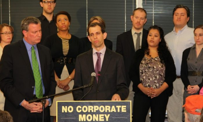 Bill de Blasio, the Public Advocate for the City of New York (left) and Robert Weissman (middle), the President of Public Citizen, launching 'Our Democracy is Not for Sale' initiative at the SEIU headquarters in Washington D.C. March 12. The initiative combines America's most prominent advocacy groups in asking corporate America not to use treasury funds to influence the U.S. elections, warning that they will use shareholder meetings, boycotts, rallies and the legal process to stop it. (Shar Adams/The Epoch Times)