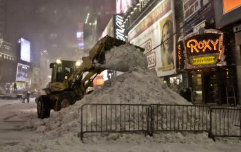 BLIZZARD OF 2010: Snow is cleared at Times Squares on Dec. 26, during the historic blizzard that dropped two feet of snow on New York City.  (Phoebe Zheng/The Epoch Times)