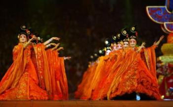 Female dancers wore ghostly makeup at the opening ceremony. (Paul Gilham/Getty Images)