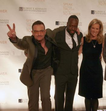 Bono (L) Wyclef Jean and Kerry Kennedy at the annual RFK Center for Justice and Human Rights Ripple of Hope Awards in Manhattan on Nov. 18, 2009. Bono and Jean received the award for their human rights efforts in Africa and Haiti. (Tim McDevitt/The Epoch TImes)