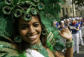 A participant from Brazil dances during the festival (ROLAND MAGUNIA/AFP/Getty Images)