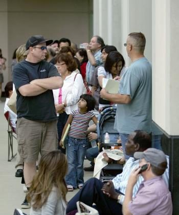 BREADLINE: Hundreds of nervous customers wait in line to get into an IndyMac Bank, open for the first time since the July 11 federal government takeover of the thrift on July 14, 2008 in Pasadena, California. IndyMac, which was already in trouble because  (David McNew/Getty Images)