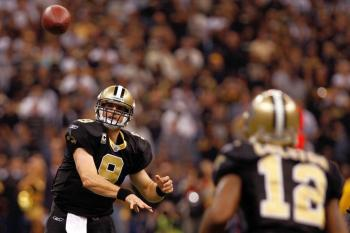 Saints QB Drew Brees tosses a pass to Marques Colston. (Chris Graythen/Getty Images)
