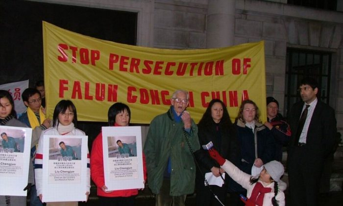 A rally held in London on Dec. 30, 2003, protests the death of Liu Chengjun, part of the team who broke through the Chinese regime's propaganda by tapping into Changchun TV. Five of the team died in prison after suffering torture. (Minghui.org)