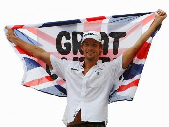 Jenson Button of Great Britain and Brawn GP celebrates clinching the F1 World Drivers' Championship during the Brazilian Formula One Grand Prix at the Interlagos Circuit on October 18, 2009 in Sao Paulo, Brazil. (Mark Thompson/Getty Images)