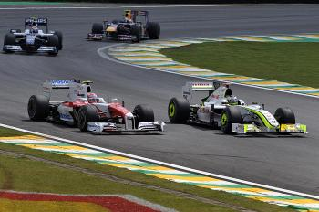 Jenson Button (R) of Brawn GP overtakes Timo Glock of Toyota, during the Brazilian Grand Prix at the Interlagos racetrack, in Sao Paulo, Brazil. (Mauricio Lima/AFP/Getty Images)