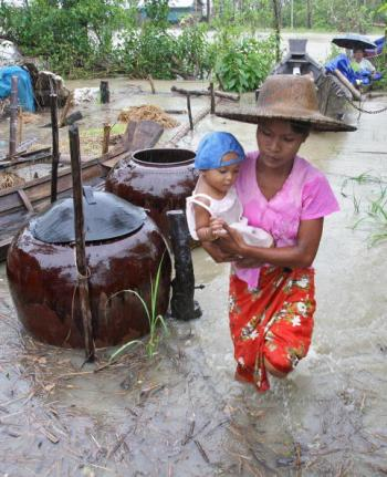 International aid organisations are relying greatly on the local population to implement relief and reconstruction funds in the Ayeyarwady Delta. (Khin Maung Win/AFP/Getty Images)
