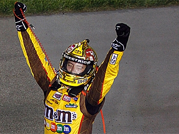 Kyle Busch, driver of the #18 M&M's Toyota, celebrates with after winning the NASCAR Sprint Cup Series Crown Royal Presents the Heath Calhoun 400 at Richmond International Raceway. (Jason Smith/Getty Images for NASCAR)