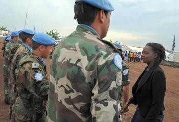 French Secretary of State in charge of Foreign Affairs, Rama Yade (L) meets United Nations Mission in the Democratic Republic of Congo (MONUC) soldiers from the Uruguayan contingent on November 30, 2008 in Goma. Under pressure from the Congolese government, the UN will be pulling 2000 peacekeepers out of country by the end of June 30. (Tony Karumba/AFP/Getty Images)