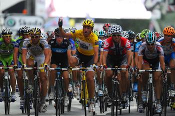 Fabian Cancellara (C) asks the riders not to sprint to support the riders who crashed during Stage Two of the 2010 Tour de France. (Pascal Pavani/AFP/Getty Images)