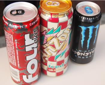 Caffeinated alcoholic beverages (CABs) like Four Loko (L) are being sold in 23.5-ounce cans and contain 12 percent alcohol. The Four Loko packaging looks strikingly similar to a can of Arizona iced tea (Center). (Catherine Yang/The Epoch Times)