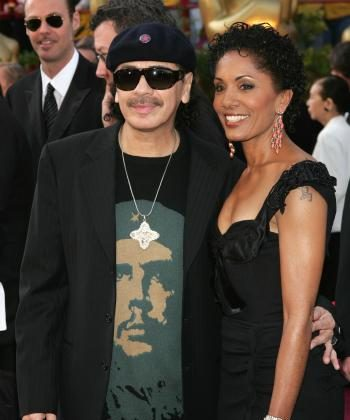 Sporting his Che Guevara T-shirt, musician Carlos Santana and his wife Deborah King Santana arrive at the 77th Annual Academy Awards in February 2005.  (Frank Micelotta/Getty Images)