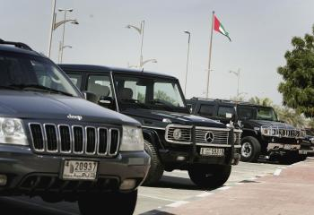 Luxury cars sit in a car park on  in Dubai, United Arab Emirates. (Chris Jackson/Getty Images)