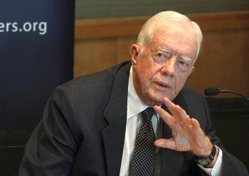 Former U.S. president Jimmy Carter, a member of the Elders group, speaks during a joint press conference with other members of the group in Damascus on October 19, 2010. (Louai Beshara/AFP/Getty Images)