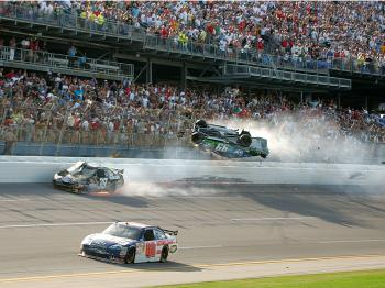 Carl Edwards flies into the catch fencing at the NASCAR Aaron's 499 at Talladega Superspeedway on April 26, 2009. If this is still happening despite restrictor plates which cripple the racing, maybe the entire concept of superspeedway racing needs to be e (Jerry Markland/Getty Images for NASCAR)