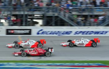 (L-R) Helio Castroneves, battles Scott Dixon while Ryan Briscoe runs third, in the final laps of the 2008 season finale at Chicagoland. (Robert Laberge/Getty Images)