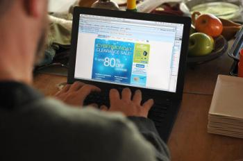 A man looks at a Cyber Monday advertisement on his laptop computer in Los Angeles on November 30, 2009. (Robyn Beck/AFP/Getty Images)