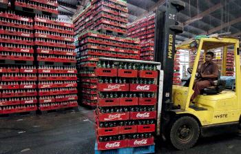 A Sri Lankan worker uses a fork-lift truck to move cases of bottles at a Coca-Cola bottling plant in Biyagama, some 25 km south of Colombo.  (Lakruwan Wanniarachchi/AFP/Getty Images)