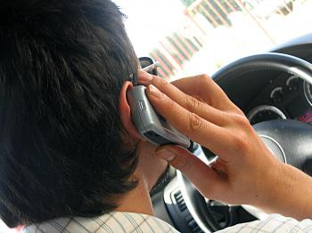 Drive while you are driving, talk when you are parked, and maybe fewer people will use their cell phones to report traffic accidents. (Dragan Sasic/Stock.Xchng)