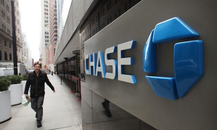 A man walks past a Chase sign at the company's Manhattan headquarter's on Jan. 13 in New York City. JPMorgan Chase has had a rash of negative publicity recently. (Spencer Platt/Getty Images)