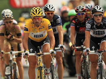 Fabian Cancellara (in yellow) crosses the finish line of Stage Seven of the Tour de France, 14 minutes behind Suylvain Chavanel. (Spencer Platt/Getty Images)