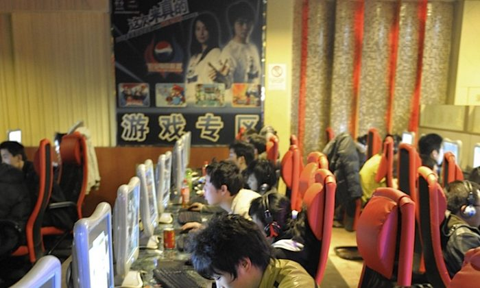 Chinese netizens play online games at an internet cafe in Beijing on February 27, 2010. Recently, politically sensitive terms normally censored from search results suddenly returned links to taboo websites that were blocked in China just the day before. (Liu Jin/AFP/Getty Images)
