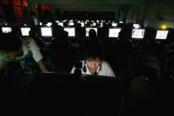 A young man in a cyber cafe in Wuhan, China, sits at work at a computer. The Chinese regime encourages individuals known as 'patriot hackers' to steal information from governments and companies. (Cancun Chu/Getty Images)