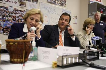 TIGHT RACE: New Jersey Republican nominee for Governor Chris Christie (C) and his running mate Sheriff Kim Guadagno (L) make some phone calls to voters at Monmouth County Republican Headquarters on Tuesday in Freehold, New Jersey. (Hiroko Masuike/Getty Images)
