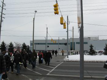 IDLE TIME: Workers cross the street after leaving of Chrysler's Warren Stamping and Truck Assembly Plant in Michigan.  (Jeanmarie Lunsford/The Epoch Times)