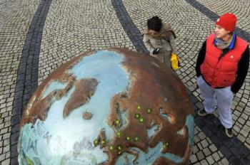 People stop to look at a globe part of an art installation entitled 'Cool Globes', an exhibition about combating global warming and climate change in Kongens Nytorv in Copenhagen on December 8, 2009. (Adrian Dennis/AFP/Getty Images)