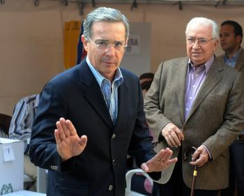 Colombian President Alvaro Uribe waves to journalists after casting his vote during the legislative elections, in Bogota on March 14. Uribe is considering a hostage swap with Colombia's largest rebel group, Farc. (Rodrigo Arangua/AFP/Getty Images)