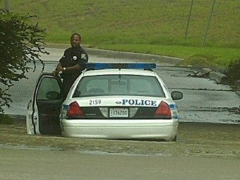 A police officer waits for assistance after his car stalled in flood waters in New Orleans, Louisiana.   (Stephen Morton/Getty Images)