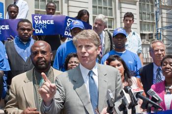 Cy Vance speaks to crowd about his plan to reduce recidivism from the steps of City Hall on Wednesday. (Cliff Jia/The Epoch Times)