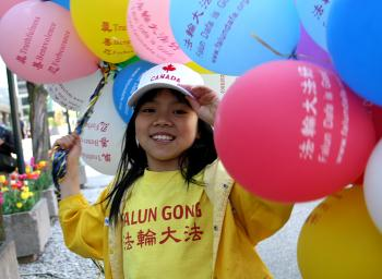 Celebration was in the air on Parliament Hill Wednesday as Falun Gong practitioners and supporters gathered to mark the 17th anniversary of the introduction of Falun Gong to the public on May 13, 1992. (Samira Bouaou/Epoch Times)