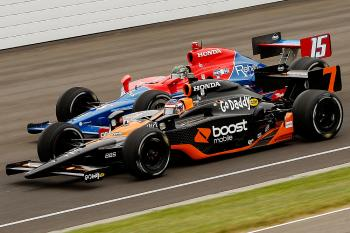 Danica Patrick in the #7 Boost Mobile Honda passes Paul Tracy in the #15 Geico Honda during the IRL IndyCar Indianapolis 500. (Chris Graythen/Getty Images)